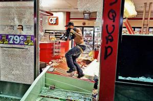 This shot, seen round the world, of a looter in Ferguson. November 24. Photo: David Carson/AP.