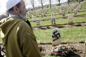 Muslim cemeteries are similarly vandalized. Notre Dame de Lorette cemetery near Arras, northern France, April 7, 2008.  Photo: Reuters/Sadouki