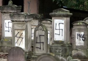 Graves desecrated by vandals with Nazi swastikas and anti-semitic slogans in the Jewish cemetery of Brumath close to Strasbourg, October 31, 2004. Jewish cemeteries have been, and continue to be, targeted as antisemitism rises in France. (photo: Reuters)