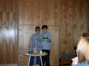 My boys lighting the Chanukah menorah, 2006.