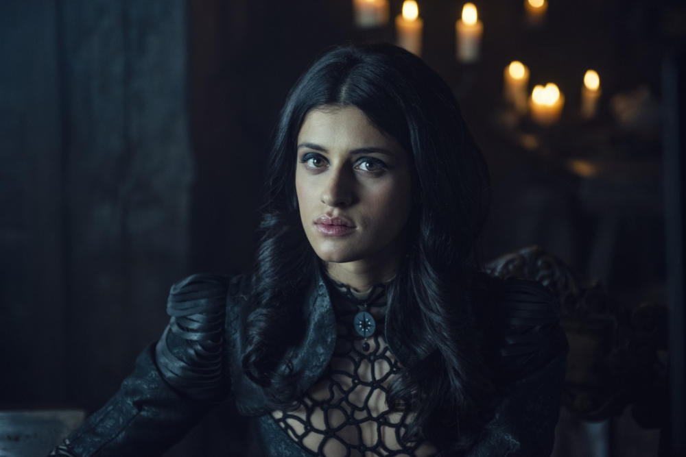 Anya Chalotra as Yennefer of Vengerberg, a light-skinned woman with dark eyes and long black hair parted down the middle, from the Netflix series The Witcher.