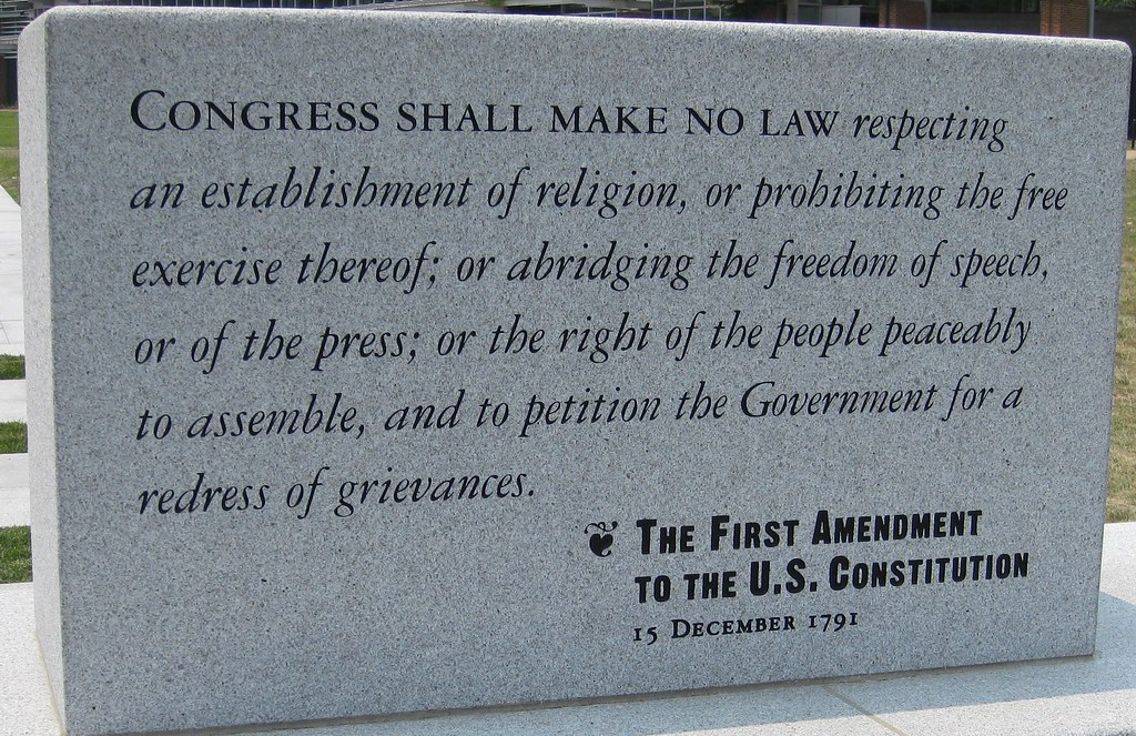 "A photo of a granite monument carbed with, ""Congress shall make no law respecting an establishment of religion, or prohibiting the free exercise thereof; of abridging the freedom of speech, or of the press; or the right of the people peaceably to assemble, and to petition the Government for a redress of grievances. The First Amendment to the US Constitution, 15 December 1791."""