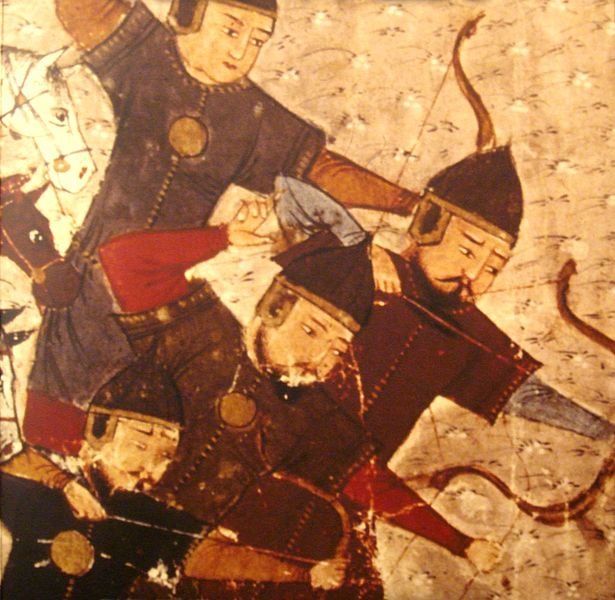 Four Asian archers in armor, all facing to one side as they fire arrows at an unseen enemy.