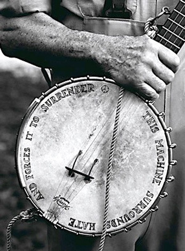 "Pete Seeger's banjo says ""This Machine Surrounds Hate and Forces it to Surrender."""