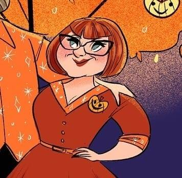 Cartoon image of Melissa in a red-orange shirtwaist dress with orange details, including a pumpkin brooch. Melissa has short red hair with bangs and wears black-framed glasses.